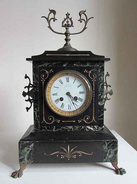 Каминные часы из бронзы и камня